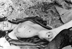 1945 Bergen-Belsen Concentration Camp in Germany. The body of a young female inmate.