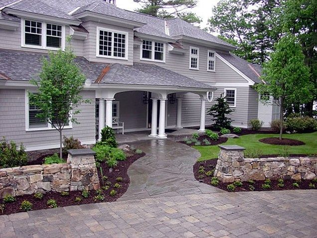 Front flagstone walkway entrance walls front yard for Home walkway ideas