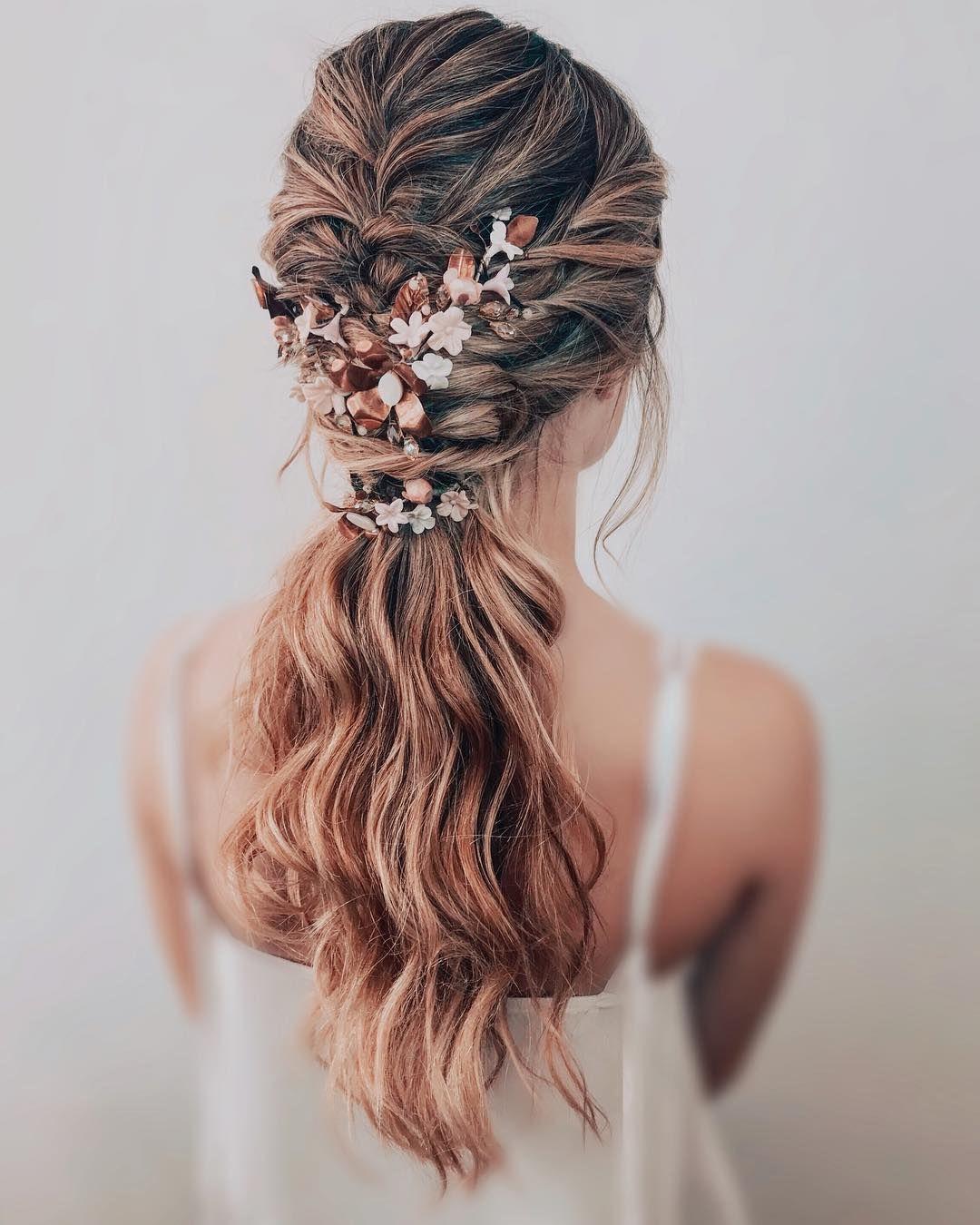 Low ponytail + hidden brads