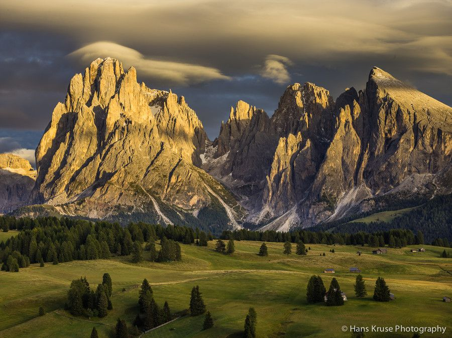 Lenticular clouds forming over Sassolungo (in the Dolomites at Alpe di Siusi) by Hans Kruse