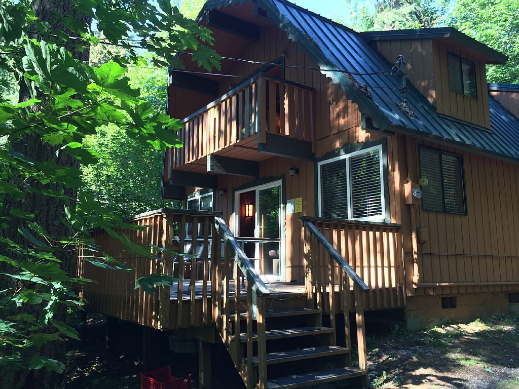 Glacier Springs 2-story, 3-bedroom, 1-bath cabin in a private wooded area, between Maple Falls and Glacier. There is a large deck with a propane gas grill and patio furniture in front of the cabin, the deck is nestled ...