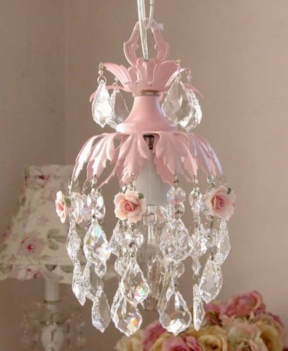 Shabby chic rose chandelier - can work with or without wiring for lights, maybe dress up a battery light! I'm thinking this would be great in the garden on the back porch...