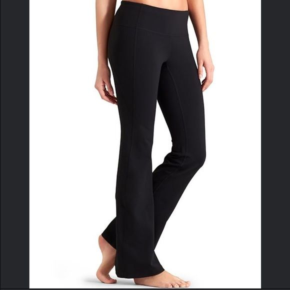 ebefa51ff6e6b Athleta Revelation Pant High performance material smoothed over everything  in these classic flare yoga pants. Thick waist band with small key pocket.
