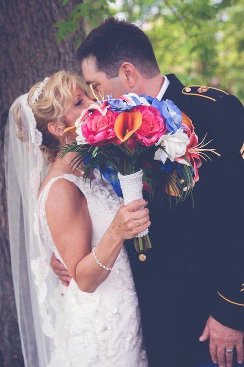 Tropical bride bouquet arranged by Wedding Designs by Kari