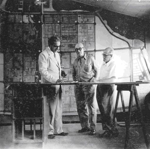 P L Varma, Le Corbusier & Pierre Jeanneret in a discussion. Note the original drafting table then in use.