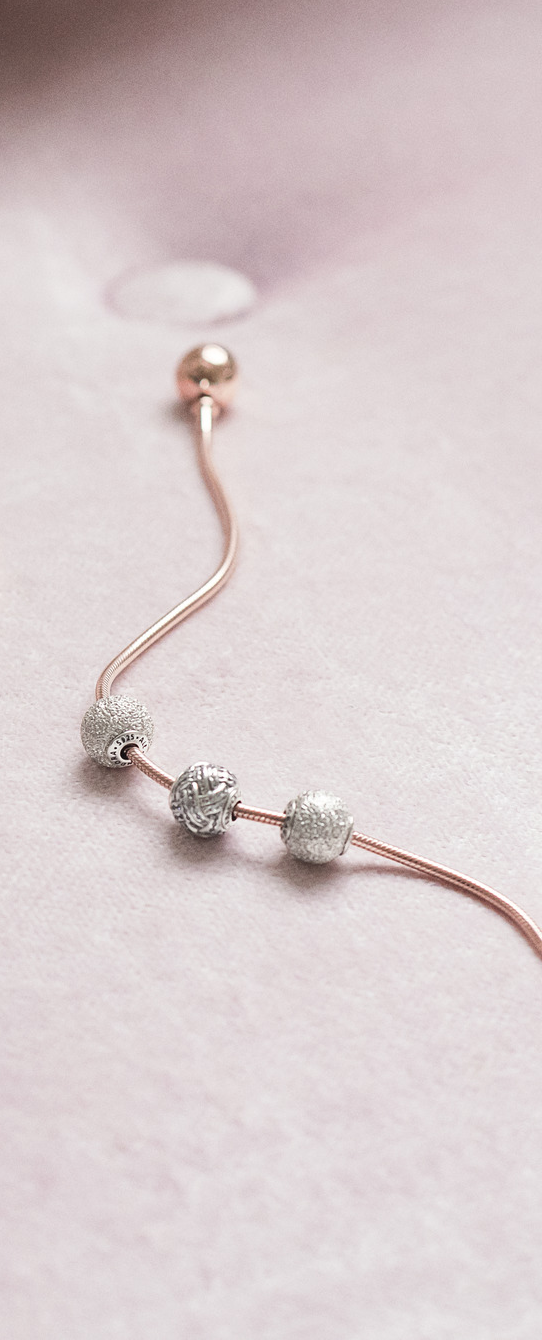 21a0f00b83e7 Adorn your PANDORA Rose bracelet with sterling silver charms from the PANDORA  ESSENCE Collection.