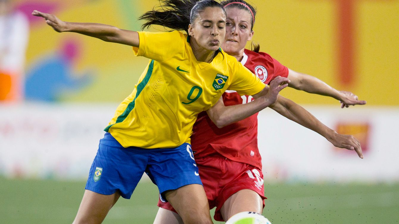 Canada's Chelsea Stewart (in red) and Brazil's Andressa Alves battle for a ball…