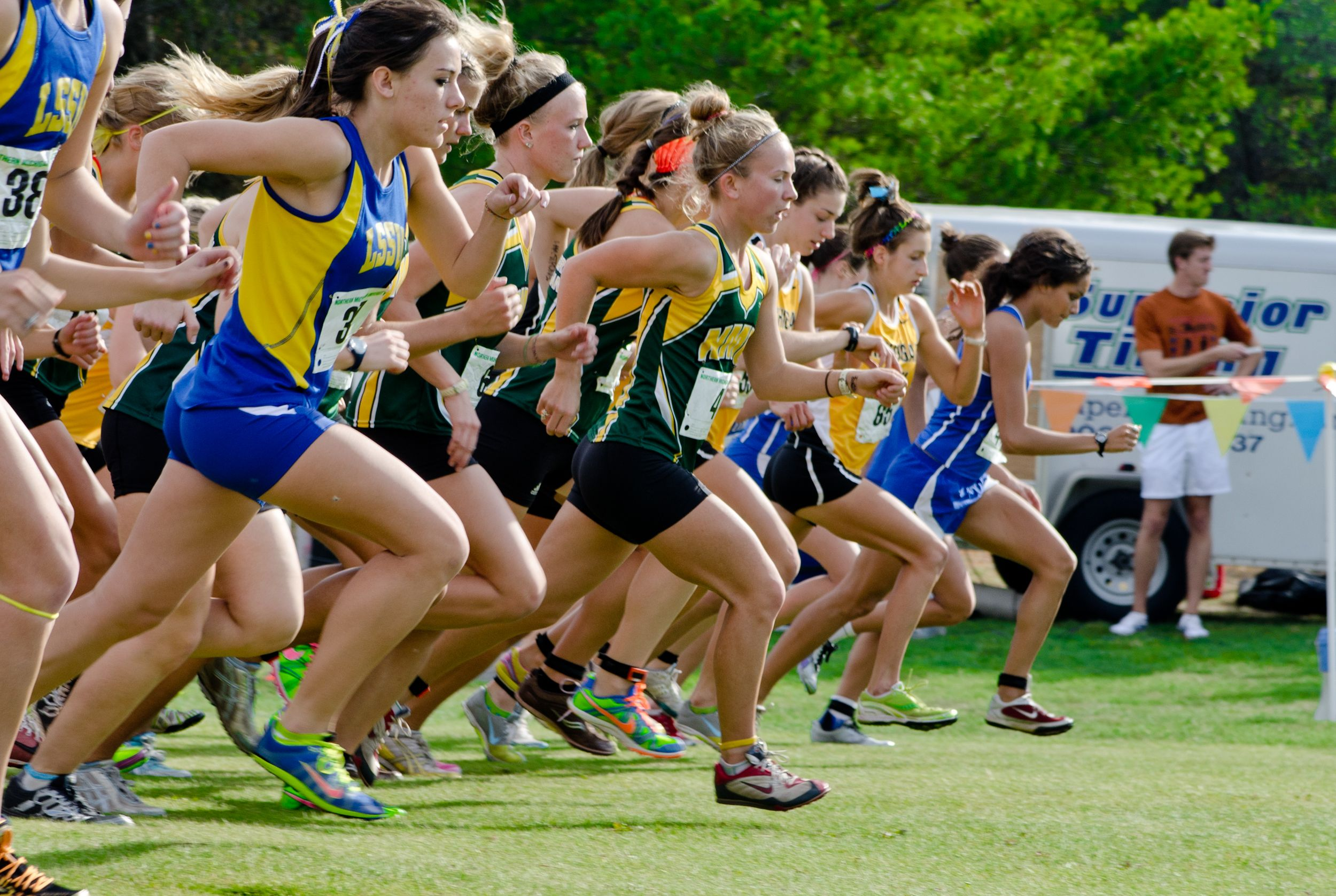 The Women S Cross Country Team Always Fights For Every Inch Led By Head Coach Jenny Ryan Northern Michigan University Sport Event Northern Michigan