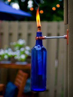 Beautiful DIY tiki torches made from wine bottles