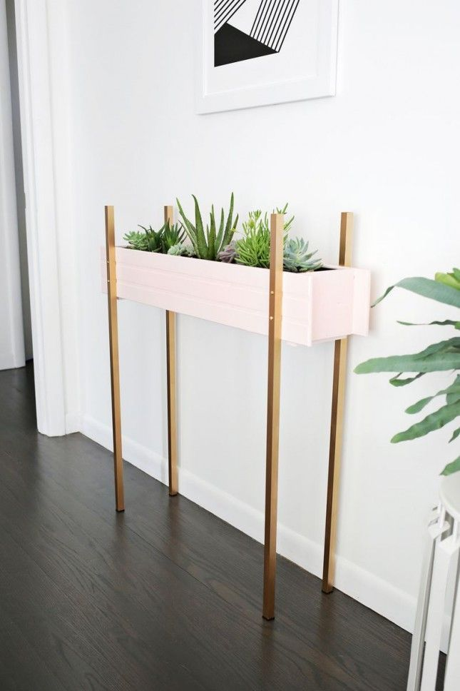 Add some green space to your foyer with this DIY skinny planter stand.