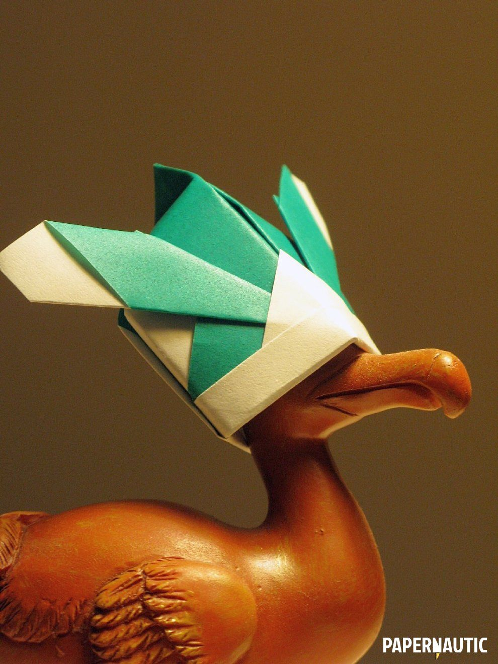 Origami samurai hat resting on the head of a small dodo statuette origami samurai hat resting on the head of a small dodo statuette jeuxipadfo Image collections