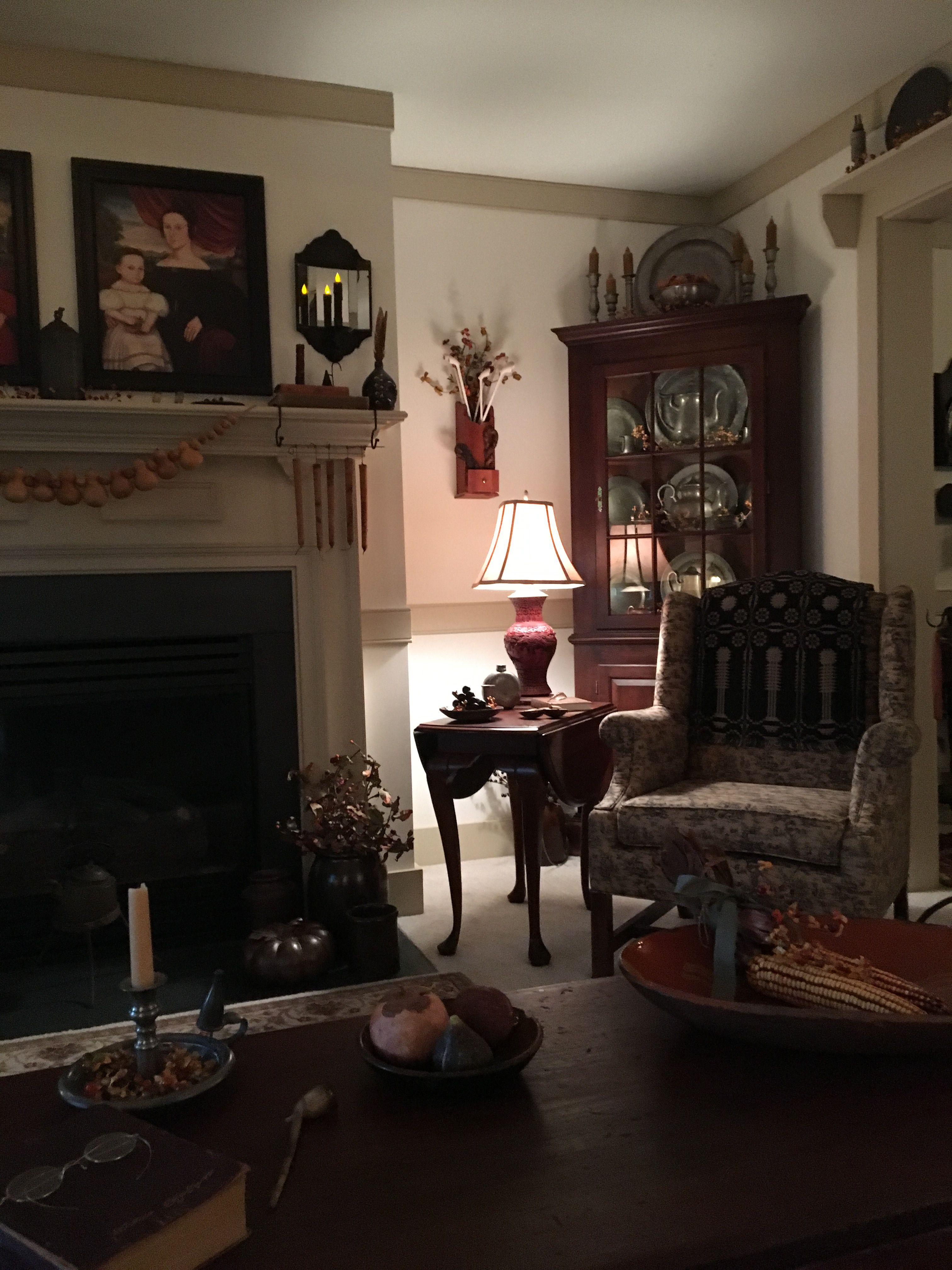 3 furnishings China closet with dishes and fireplace with pictures