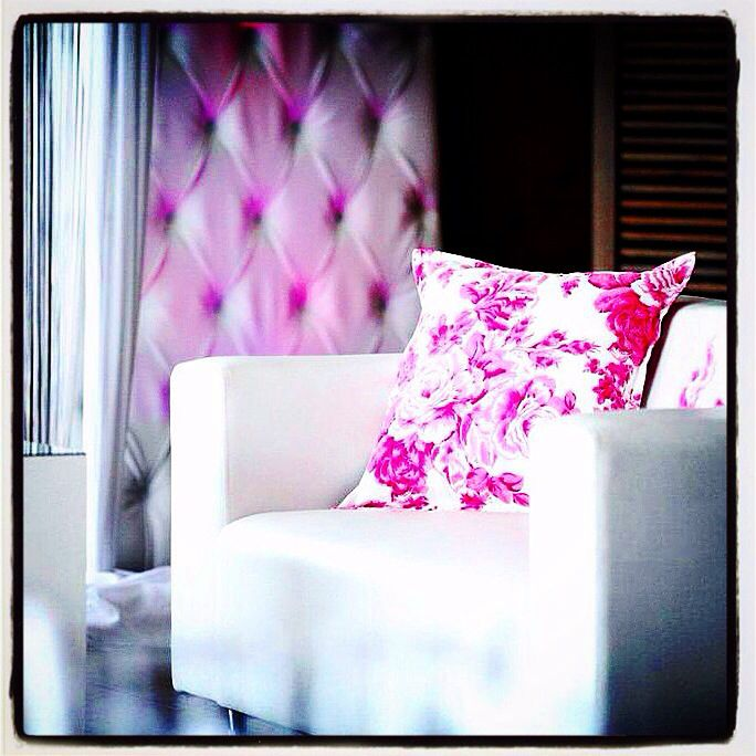 Pink Rose Cushions by Craig Adam for lounge area wedding at Netherwood, Midlands with a deep button panel in the back ground