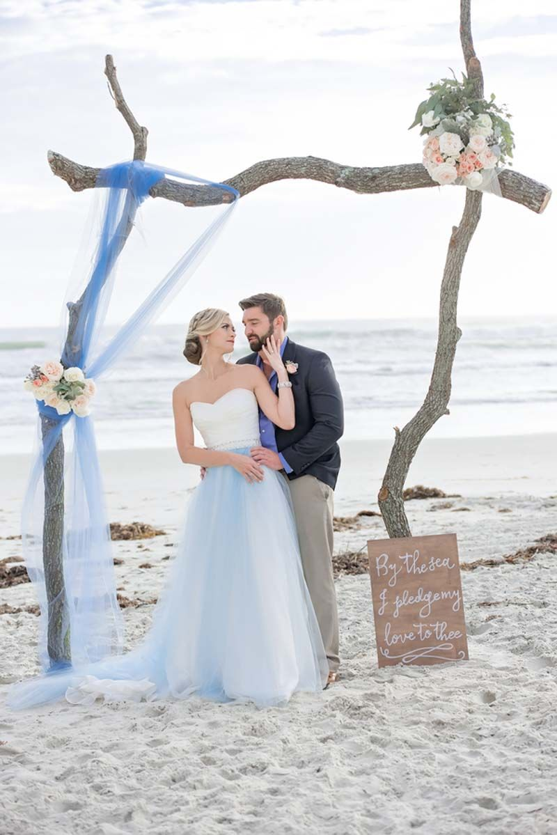 Bride and groom beach ceremony breezy and blue beach inspiration