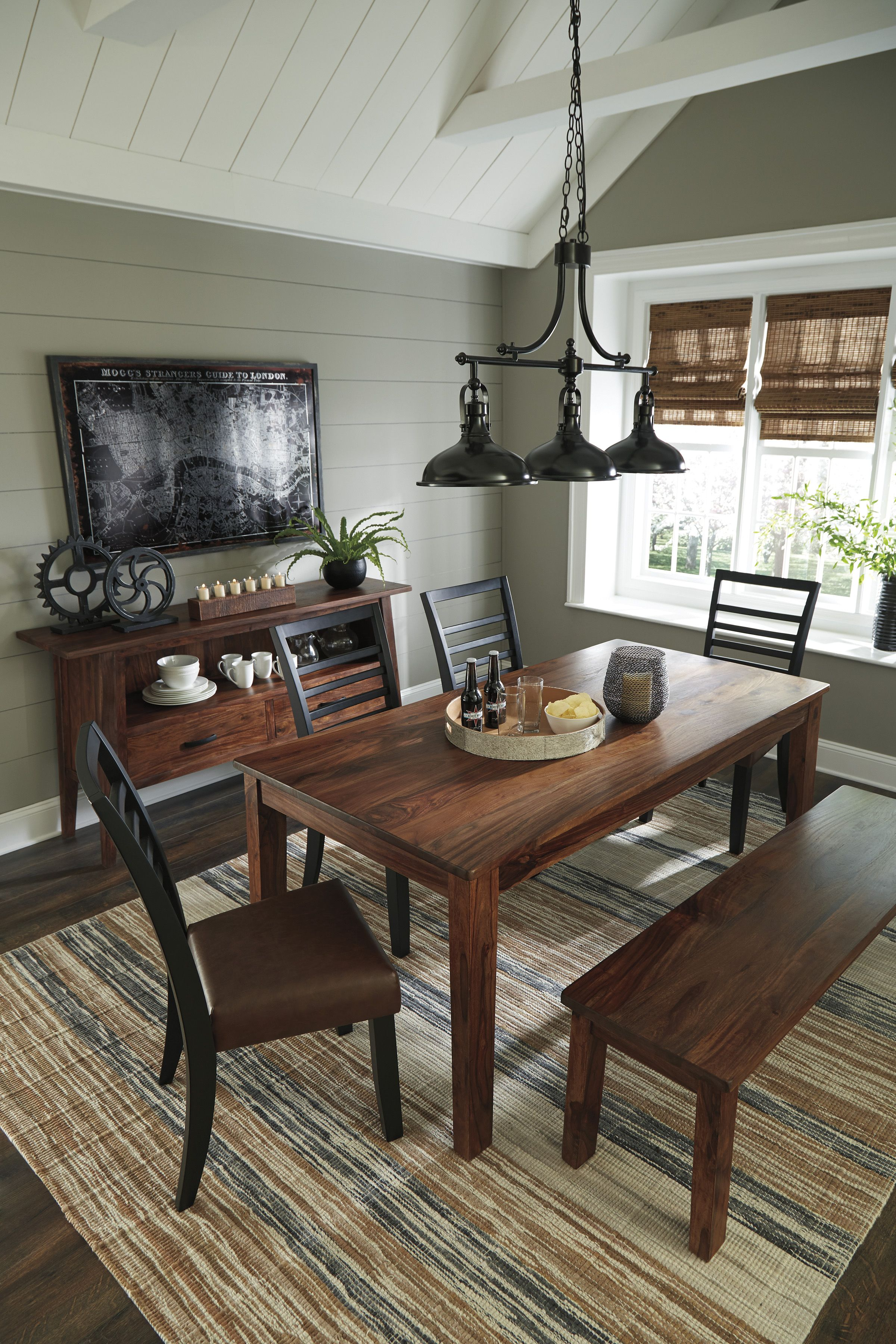 The manishore casual dining set is gorgeous with its dark wood