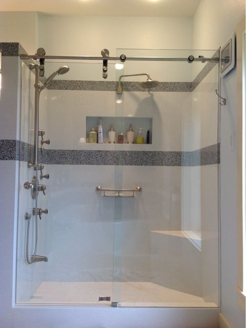 This Open Wheel System Is Modern And Sleek In Appearance Frameless Shower Glass Doors In Cincinnati And Dayton Ohio By Alluring Glass I Sliders Glass Shower Frameless Shower Glass Shower Doors