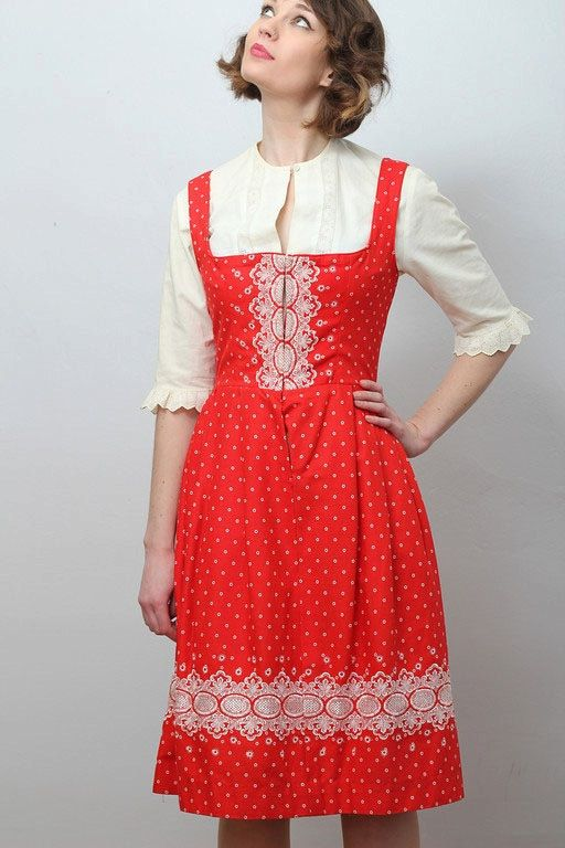 Vintage red and white embroidered dirndl - made in Salzburg, Austria. It features a gathered waistband and an embroidered bodice with a set of hook and eye closures running down its front. It also comes with a detachable linen and lace half-blouse.  via Etsy.