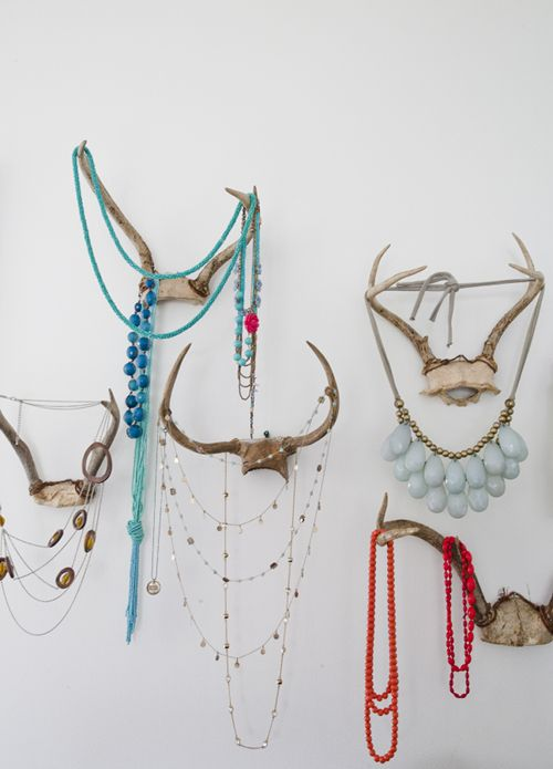 antlers + jewels! This is what I did in the master with all our antlers/skulls! All my turquoise jewelry adds color to our white/beige master! And it matches my vintage vanity!