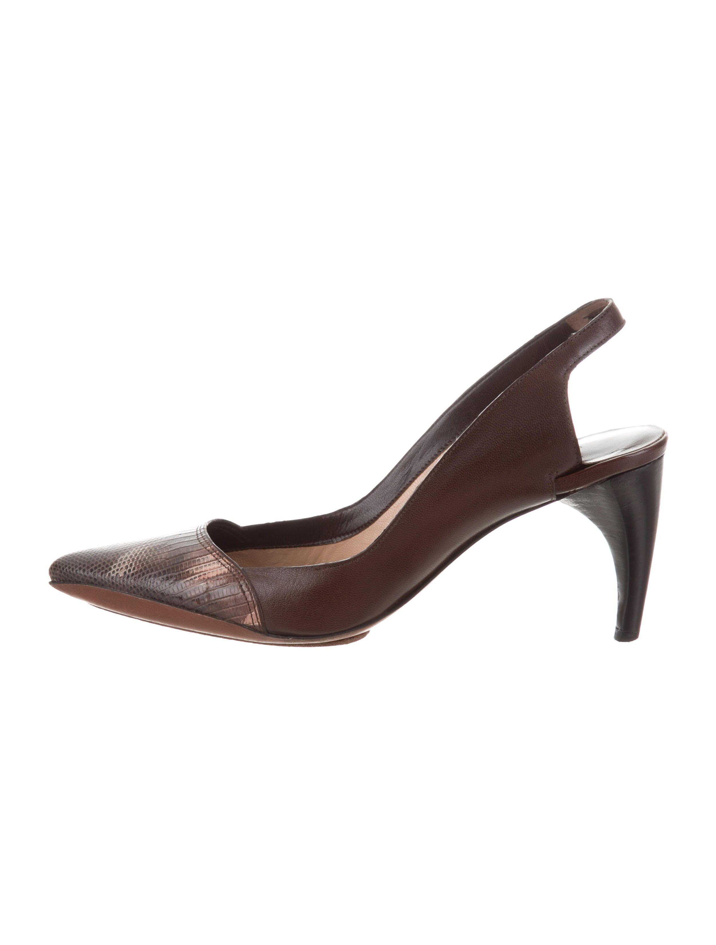 29c978128 Brown leather Costume National pointed-toe slingback pumps with embossed  cap toes and stacked heels. Includes box and dust bag.