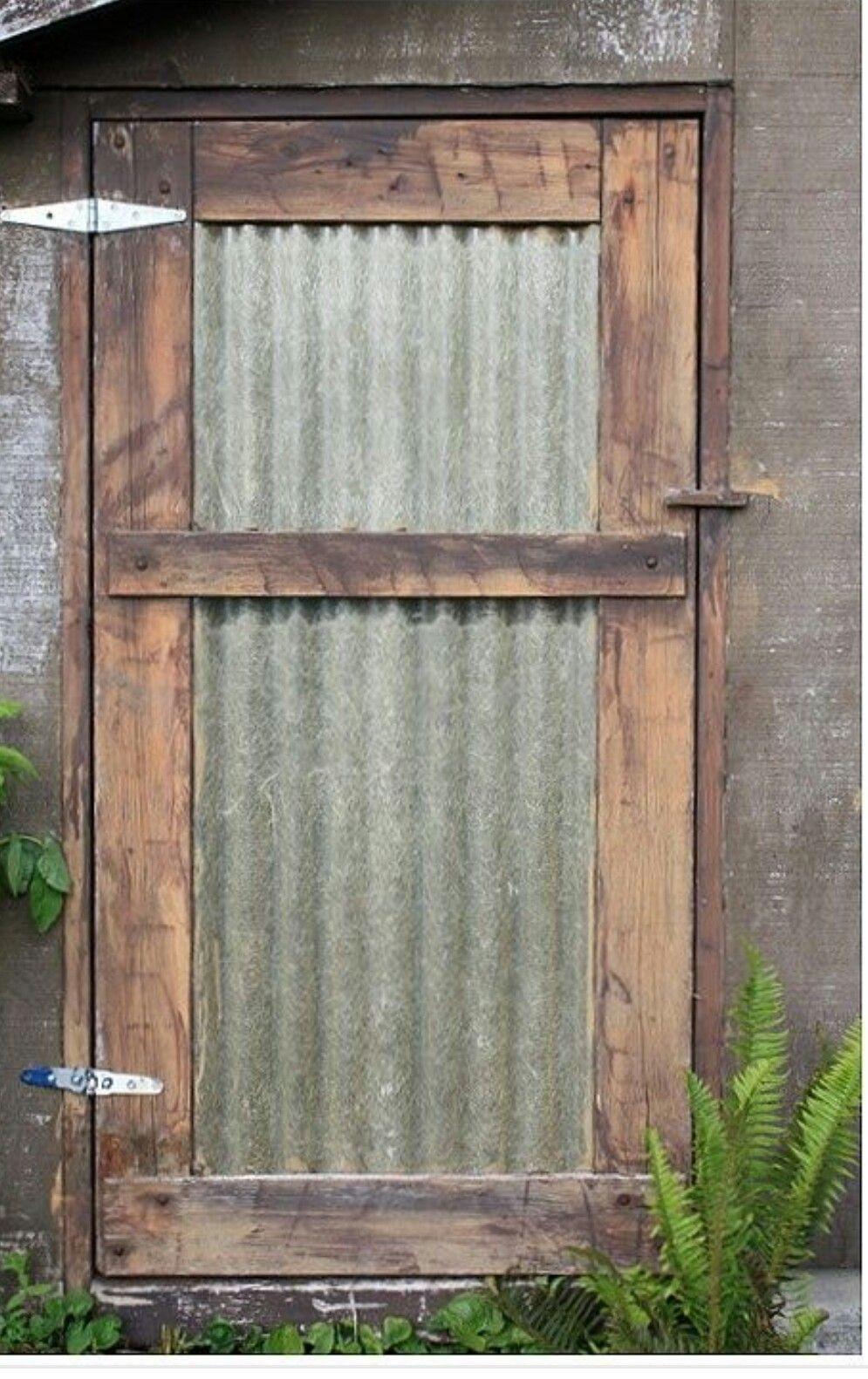 Metal roofing on door home ideas pinterest doors for Metal barn over basement