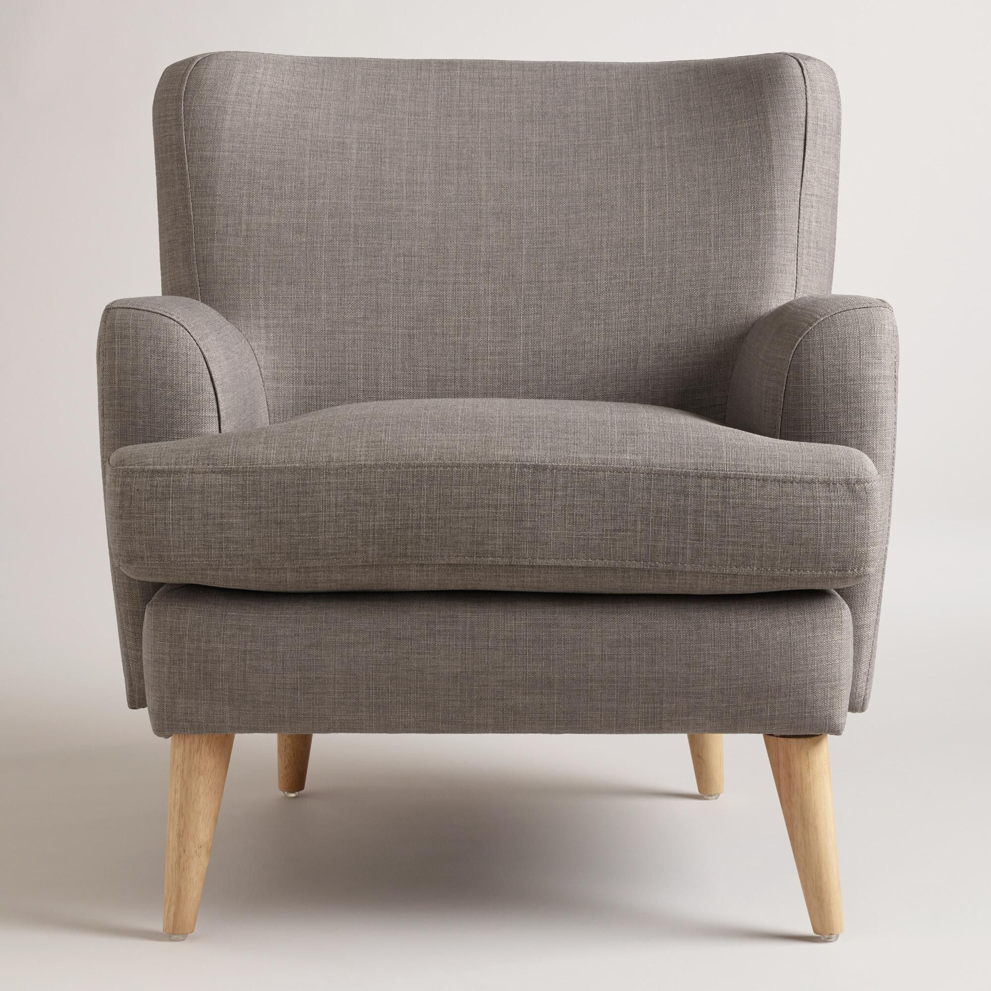 Upholstered in neutral gray woven fabric, our Danish-inspired chair exudes mid-century style with splayed legs and a classic profile.