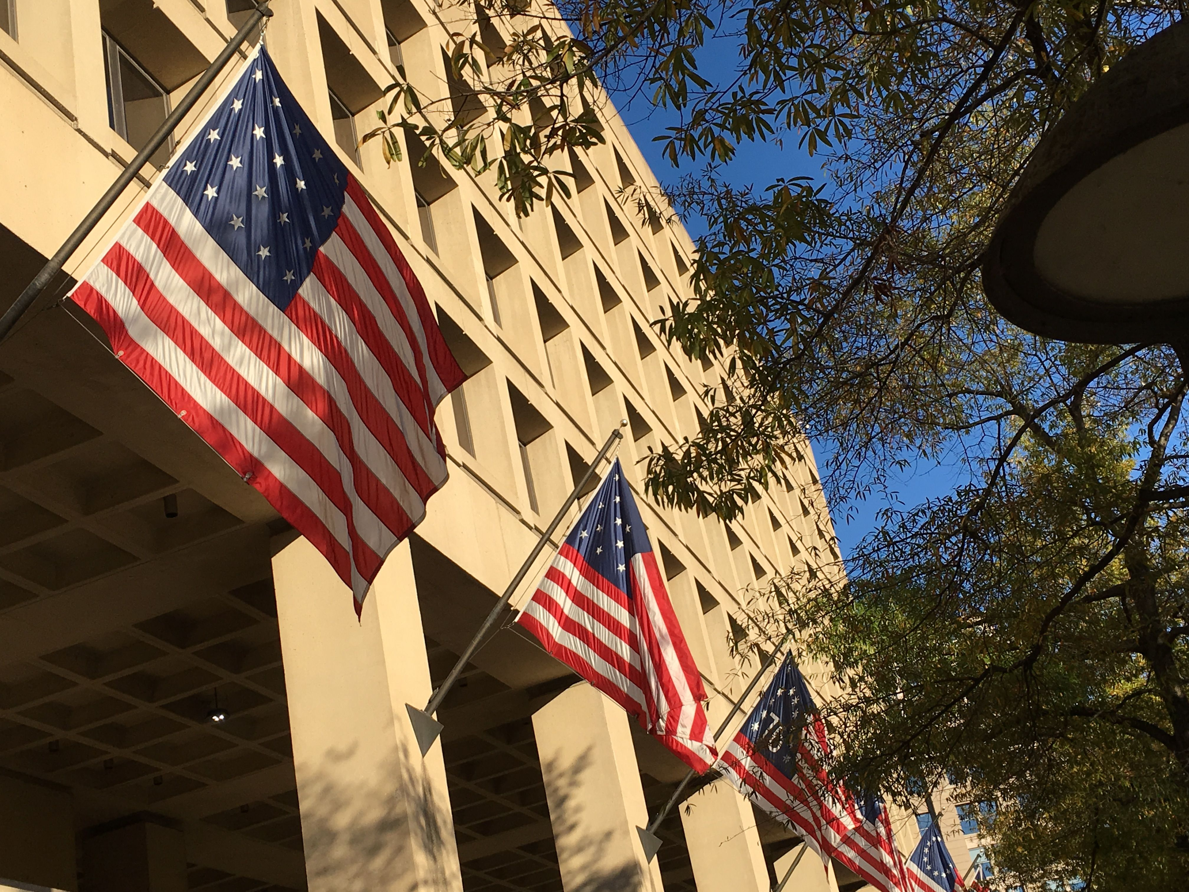 Guarding The Entrance To The Fbi S J Edgar Hoover Building In Washington D C Every Version Of The American Flag On Guard American Flag Hoover Building Flag