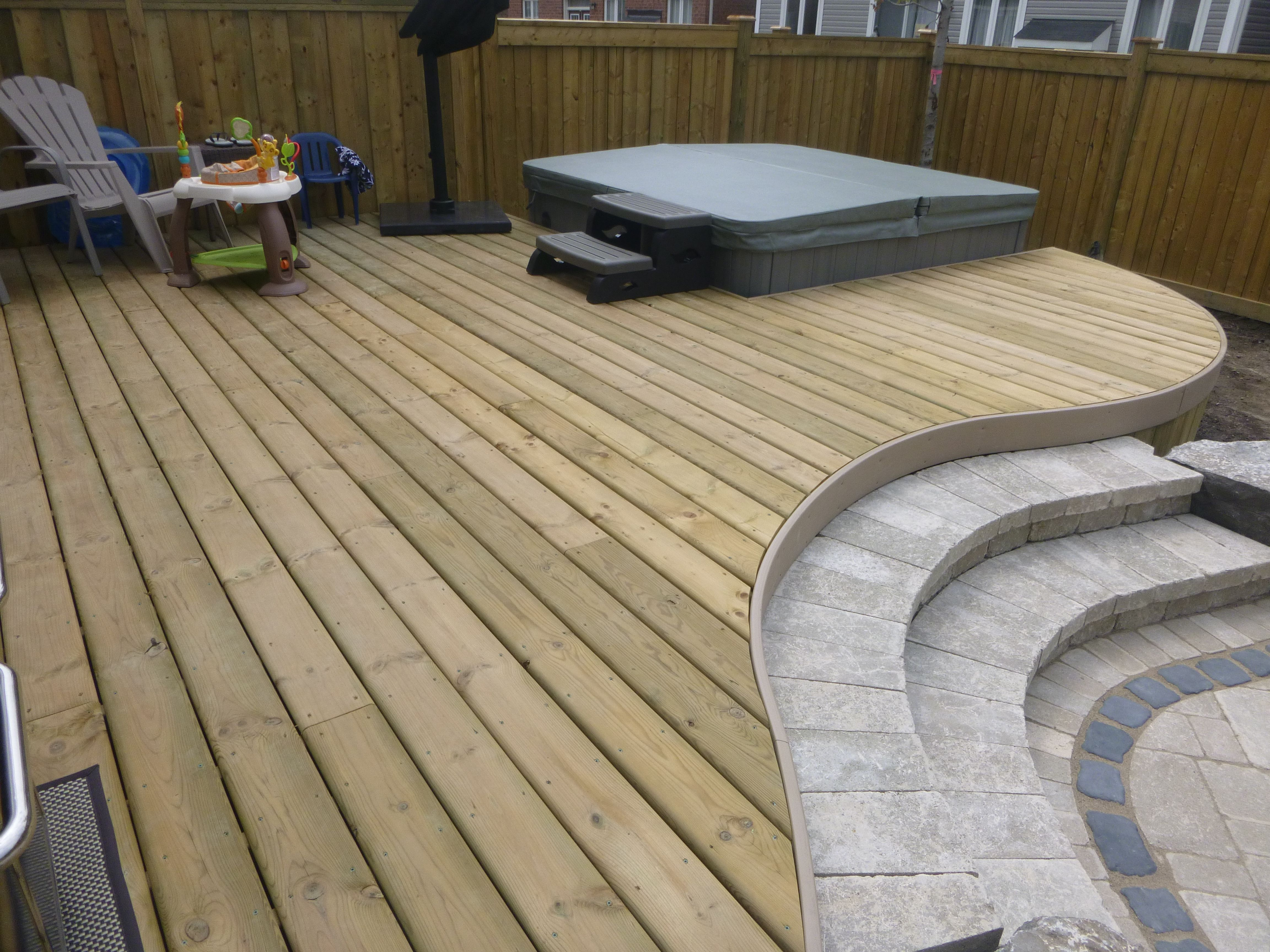 Pressure Treated Deck With Curves Pvc Trim And Stone Steps Curved Patio Deck Designs Backyard Curved Deck