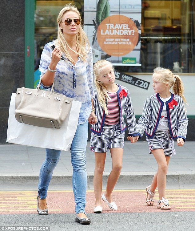 Pretty as a picture: Alex Gerrard appeared to have well and truly passed on her passion for fashion to her eldest daughters, Lilly-Ella, nine, and Lexie, seven, as they stepped out on Tuesday