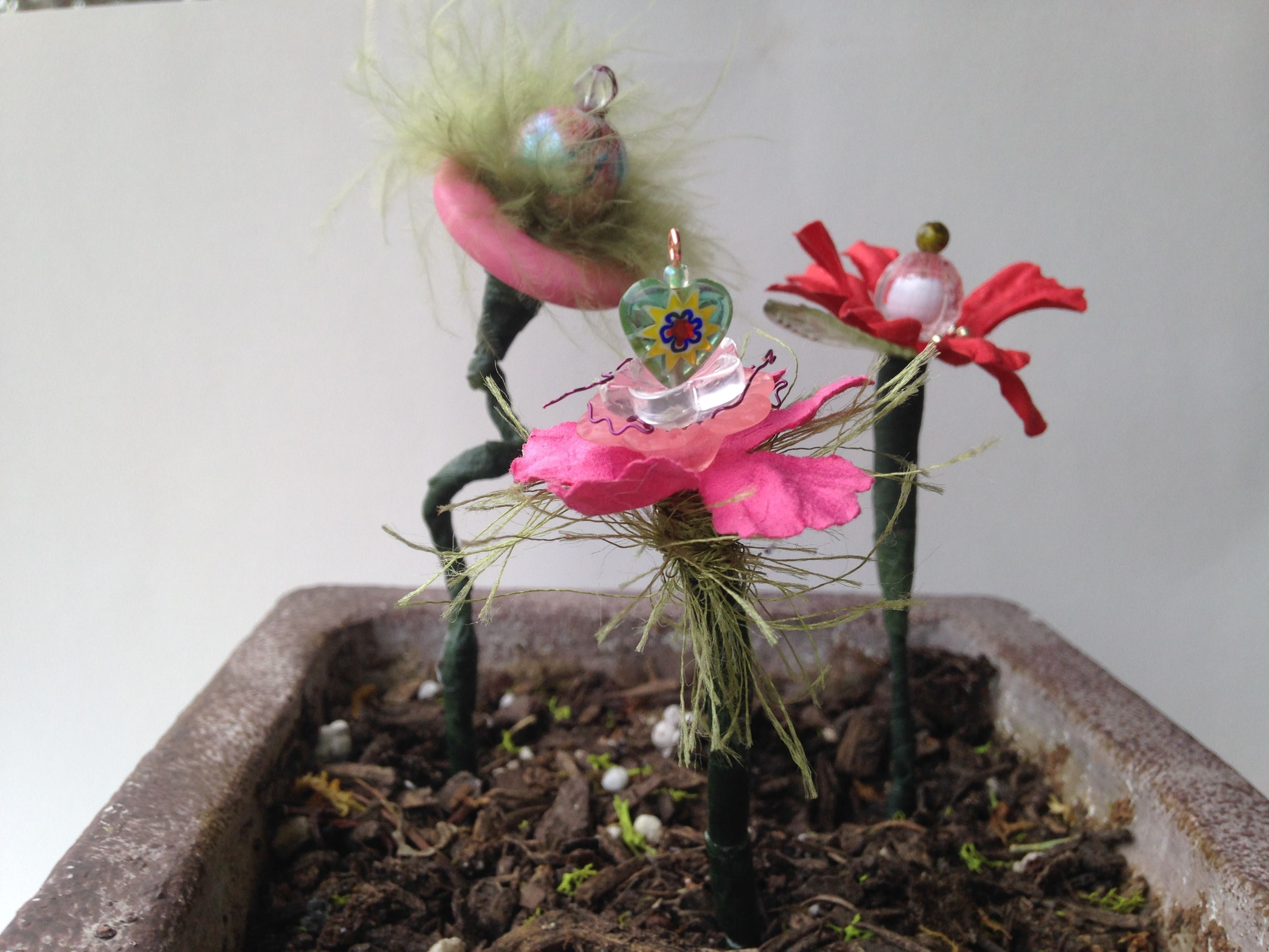 mini flowers made of beads, wire, feathers, etc. sold at my etsy store