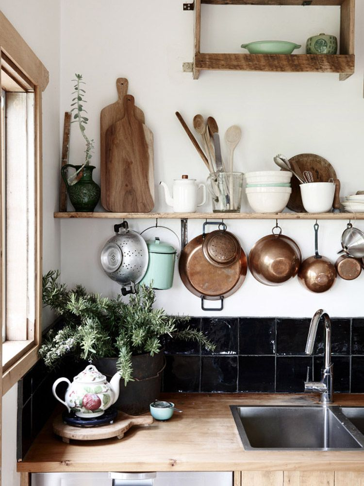 Hanging copper pots and pans and open