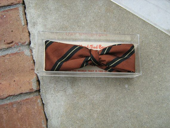 A Vintage 1950s - 1960s Cutter hand-tied bow tie new old stock in the original case from Cutter Cravat, inc. Chicago, Illinois. measure about 4-1/2 wide and 1-1/2 wide.bow ties is clean and in new condition.