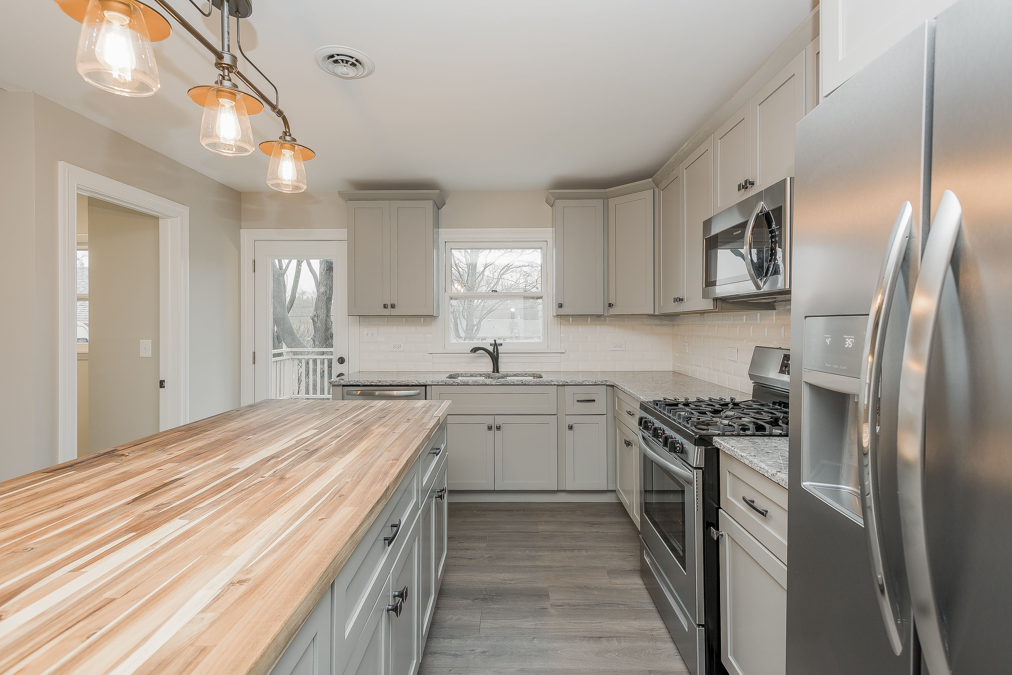 Gray Cabinets With Butcher Block And Granite Counter Tops Mixed