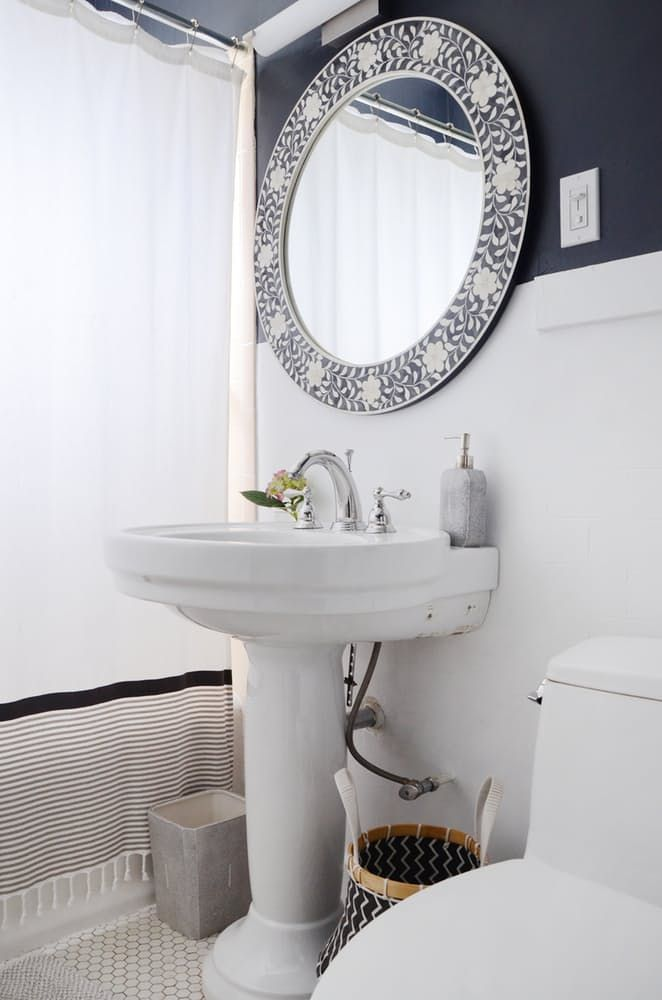This Modern Golden Girls Style Apartment Comes Together Here The Plumbing Fixtures Shower Curtain And Decor All Coordinate Perfectly With Navy Blue