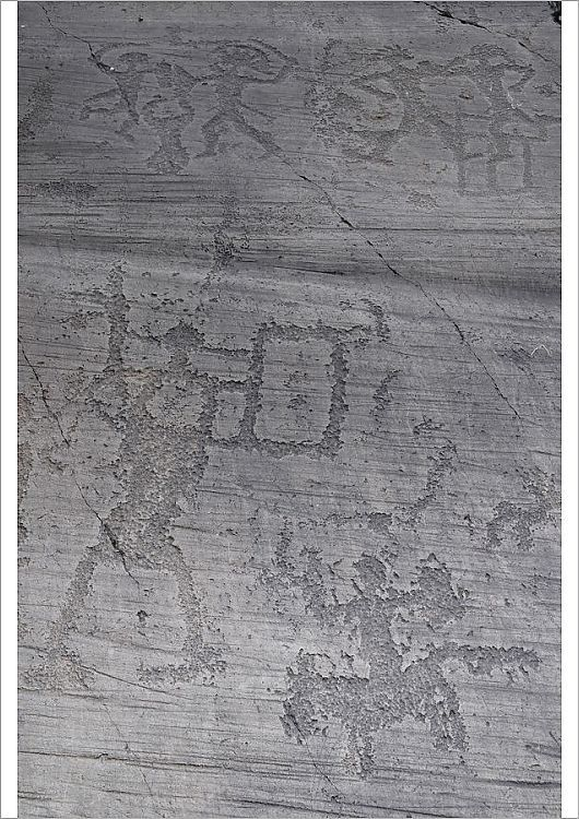 An A1 poster sized print, approx 23c33 inches (594x841 mm). Italy, Lombardy, Valcamonica, Foppi di Nadro, 1000BC rock carvings depicting battles.. rocks, rock, lombardy, carvings, pre historic, valcamonica, foppe di nadro. Image supplied by EyeUbiquitous