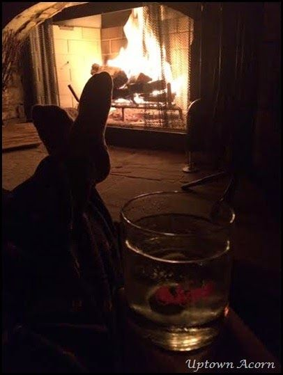 In front od the fire with a little tipple