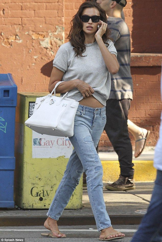 Keeping comfy: On Friday, the star had flashed her tum in a grey sweatshirt, pale jeans and flip-flops