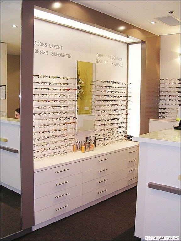 lighting idea around frame displays | Optical Shops Design ...