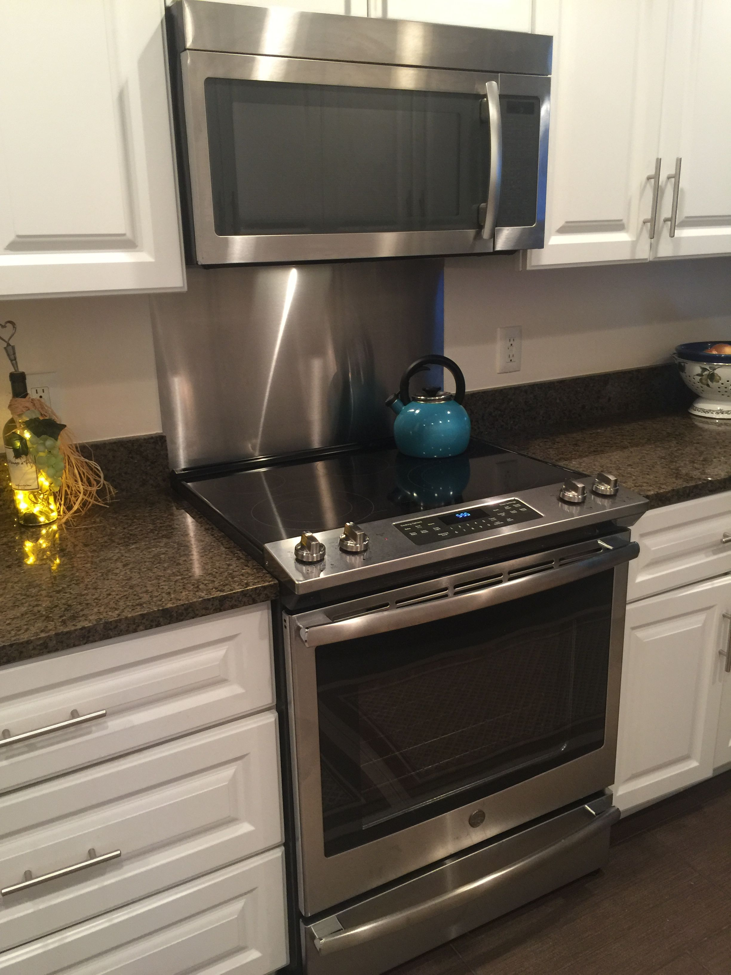 Stainless Steel Behind Slide In Range This Is Clean Best Solution F Stainless Kitchen Backsplash Appliances