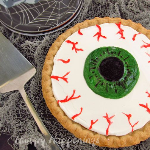 gross halloween desserts decorate a pumpkin pie to look like an