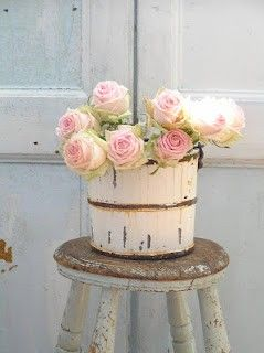 I could paint my old ice cream maker and use it as a vase!