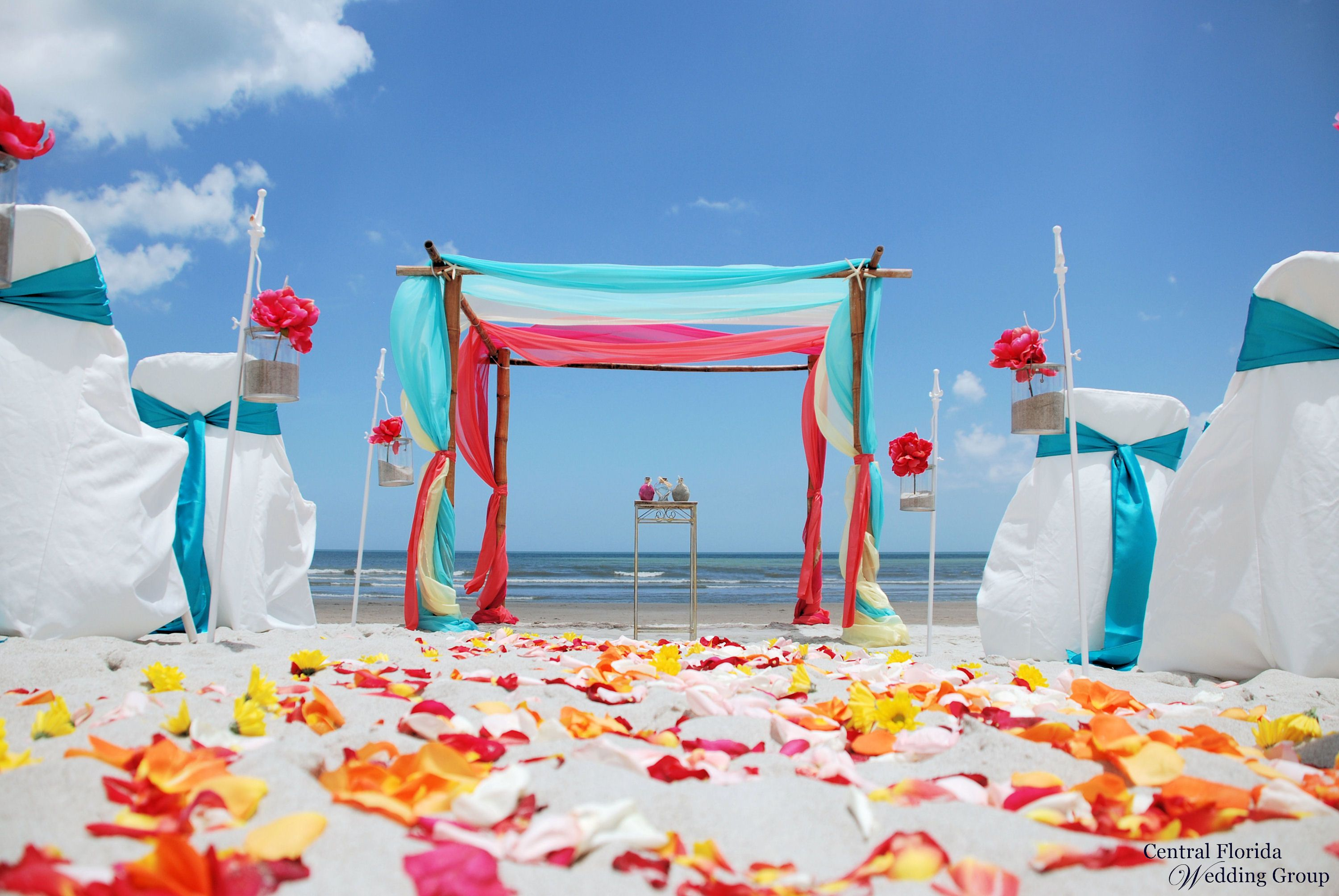 Tropical beach wedding 4 post bamboo with turquoise yellow