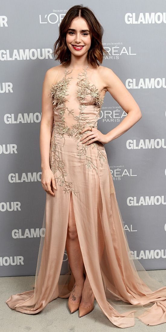 Lily Collins - At Glamour's 23rd Annual Women of the Year Awards, Lily Collins worked a flesh tone Julien Macdonald gown with a sheer front and gold embelishments.