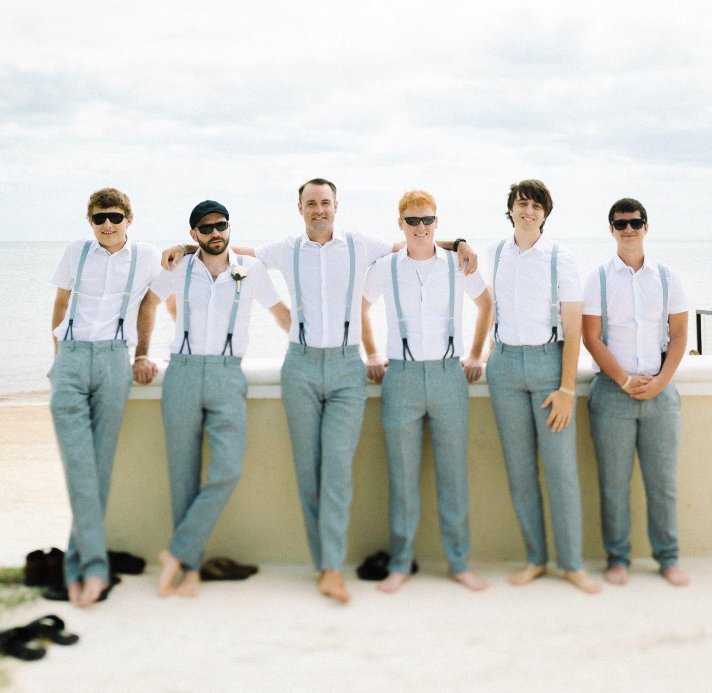Beach Wedding Outfit Ideas: Groomsmen At A Beach Wedding With Grey Slacks And Light