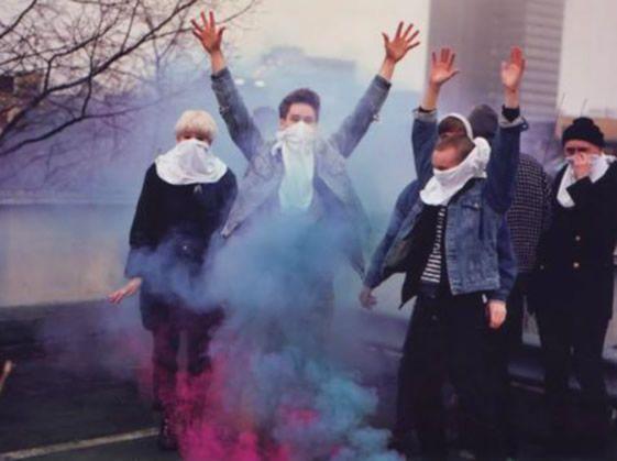 Smoke colors, handkerchiefs and raised hands.