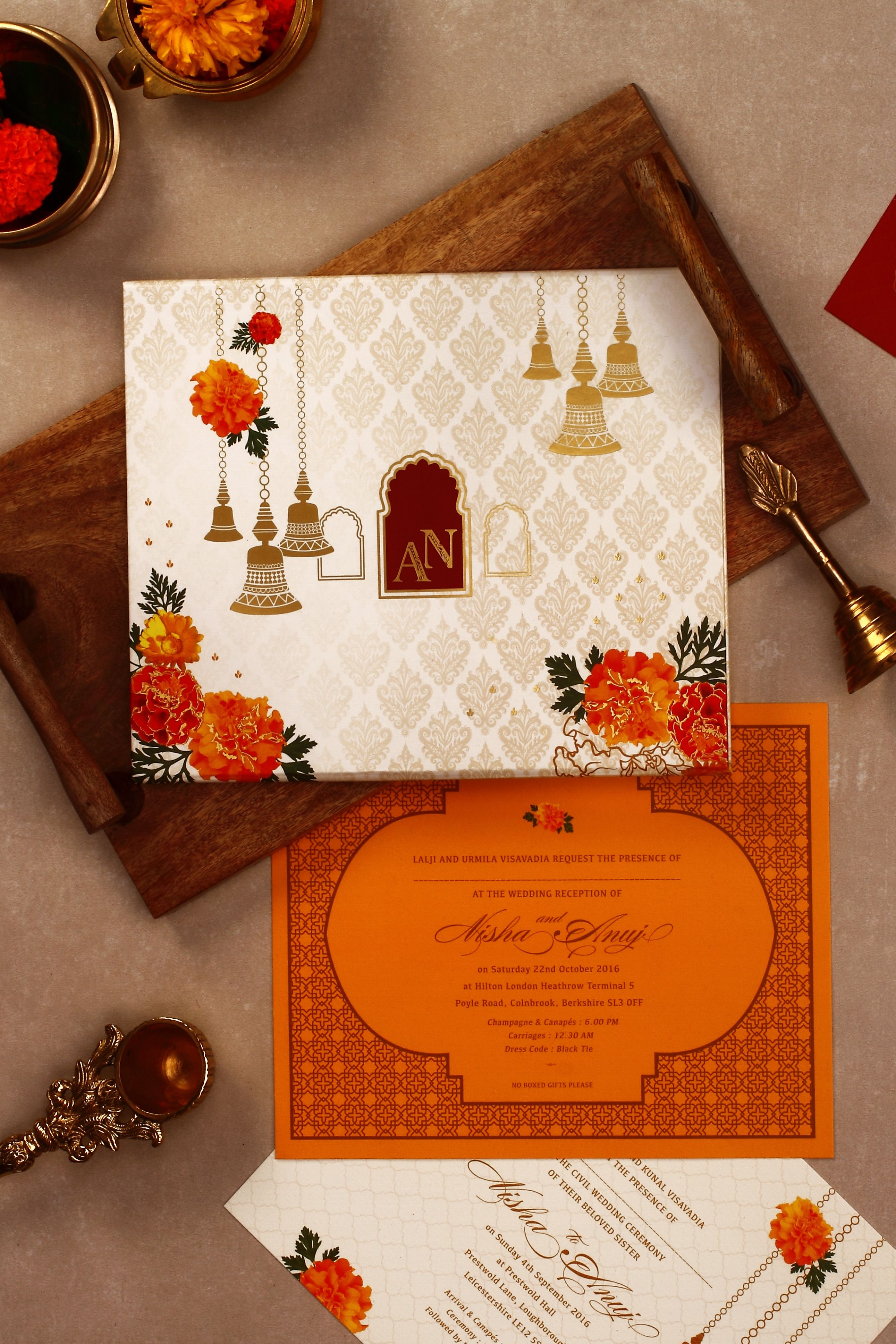 Marigold and brass bells indian wedding invitation