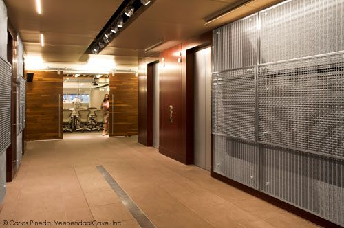 AECOM Office renovation in Atlanta included stainless wire mesh wall panels made of Banker F-48 & M13Z-187 mesh. The panels were framed with U-edge perimeter frames and held off the wall with stand-offs. Project designed by VeenendaalCave, Inc.