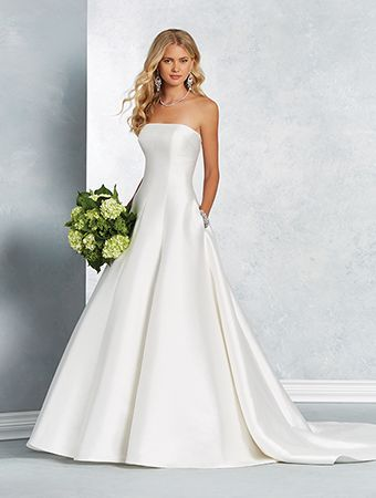 An affordable Mikado wedding gown with a strapless neckline, princess waist, A-line skirt, and cathedral train.