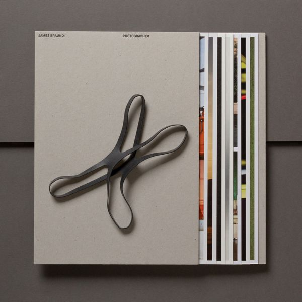 Uncoated unbleached folder with rubber band and black block foil detail designed by Hofstede for photographer James Braund