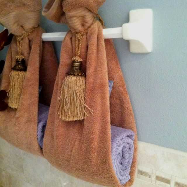 A Different Way Of Hanging Towels They Used Drapery Tassels To Tie The Towel At The Top