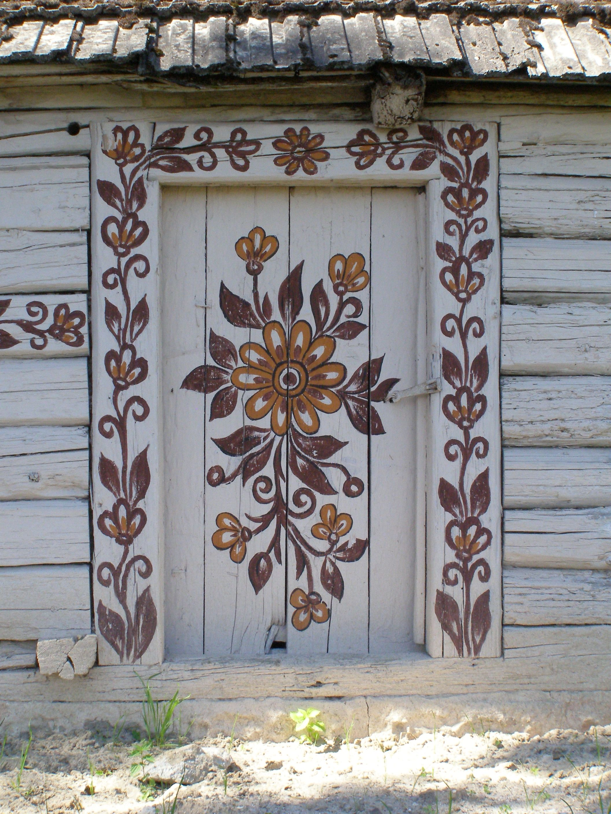 Painted Barn door in Zalipie Poland. OMG, how great would this be painted on the inside on a door? Ideas...